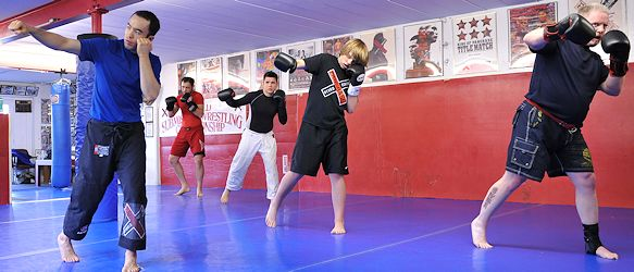 Professor Billy Hendricks with kickboxing students