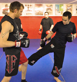 Prof. Billy Hendricks teaches kickboxing techniques