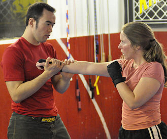 Professor Billy Hendricks teaches women's MMA class