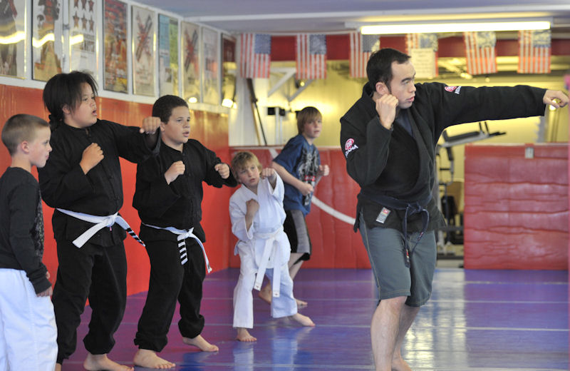Professor Billy Hendricks leads kid's MMA class