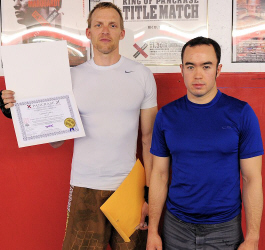 Nate Cary and Professor Billy Hendricks purple belt promotion